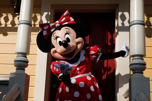 Disney character Minnie Mouse poses for photos in Disneyland Paris ahead of the 25th anniversary of the park in Marne-la-Vallee, near Paris, France, March 16, 2017. Picture taken March 16, 2017. REUTERS/Benoit Tessier