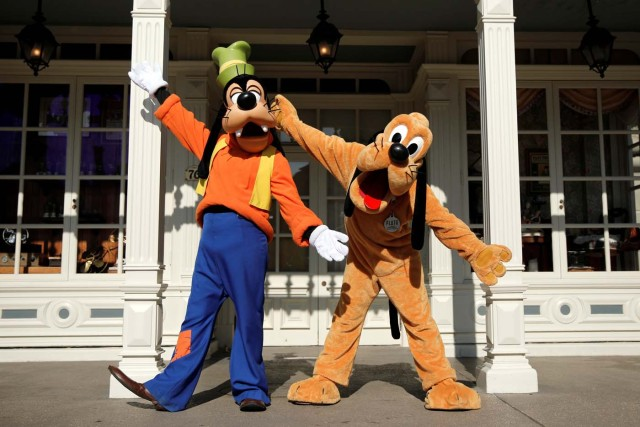 Disney characters Goofy and Pluto pose for photos in Disneyland Paris ahead of the 25th anniversary of the park in Marne-la-Vallee, near Paris, France, March 16, 2017. Picture taken March 16, 2017. REUTERS/Benoit Tessier