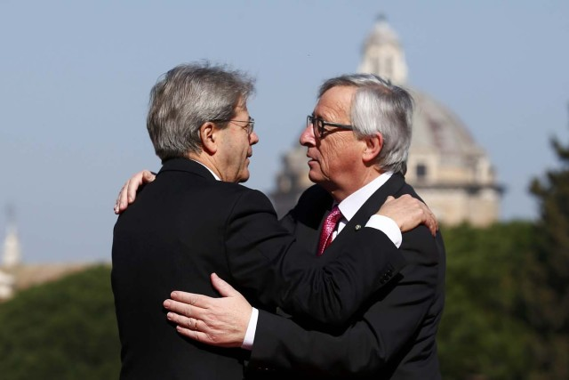 "European Commission President Jean-Claude Juncker is welcomed by Italy's Prime Minister Paolo Gentiloni outside the city hall ""Campidoglio"" (Capitoline Hill) as EU leaders arrive for a meeting on the 60th anniversary of the Treaty of Rome, in Rome, Italy March 25, 2017. REUTERS/Tony Gentile"
