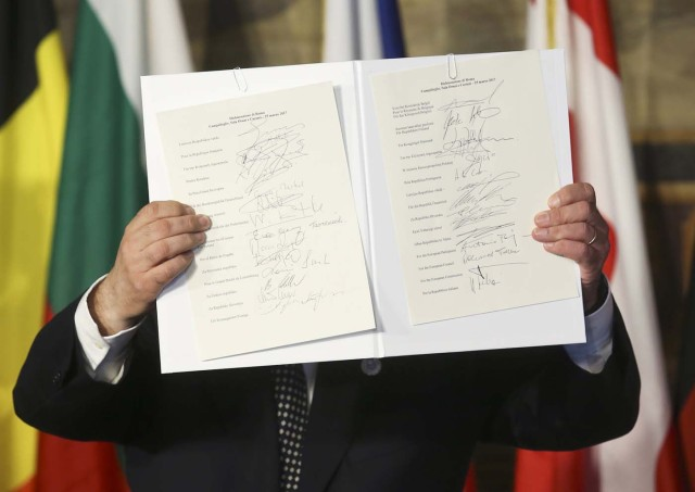 European Parliament President Antonio Tajani holds up a document signed by EU leaders during their meeting on the 60th anniversary of the Treaty of Rome, in Rome, Italy March 25, 2017. REUTERS/Remo Casilli TPX IMAGES OF THE DAY