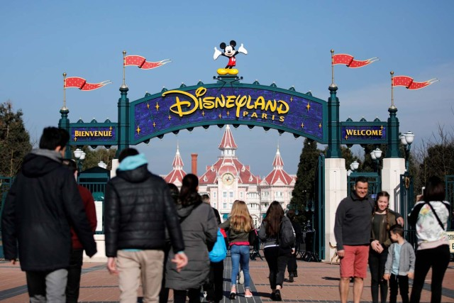 Disney character Mickey Mouse is seen above the entrance at Disneyland Paris during the 25th anniversary of the park, in Marne-la-Vallee, near Paris, France, March 25, 2017. REUTERS/Benoit Tessier