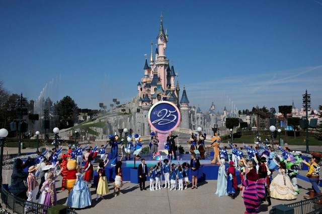 Disney characters attend the 25th anniversary of the park, at Disneyland Paris in Marne-la-Vallee, near Paris, France March 25, 2017. REUTERS/Benoit Tessier
