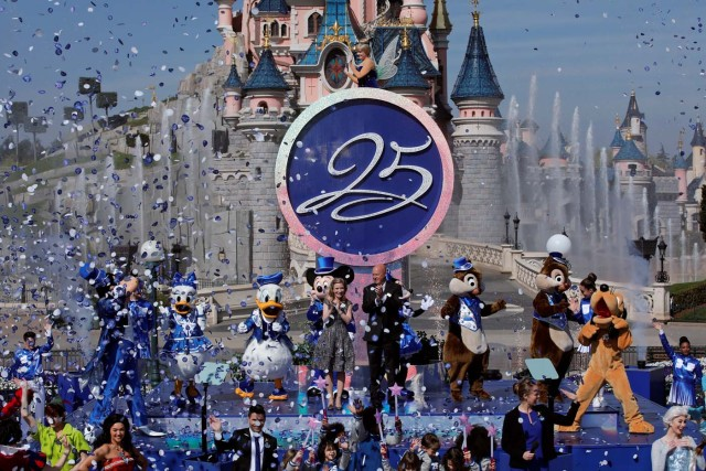 Disney characters attend the 25th anniversary of the Disneyland Paris at the park in Marne-la-Vallee, near Paris, France, March 25, 2017. REUTERS/Benoit Tessier