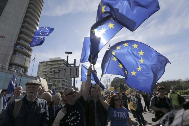 EU flags fly above demonstrators during a Unite for Europe march in central London, Britain March 25, 2017. REUTERS/Paul Hackett
