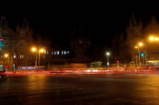 Traffic moves in front of the Chhatrapati Shivaji Terminus (CST), formerly known as Victoria Terminus, after the lights were turned off for Earth Hour in Mumbai, India, March 25, 2017. REUTERS/Shailesh Andrade