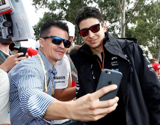 Formula One - F1 - Australian Grand Prix - Melbourne, Australia - 26/03/2017 Force India driver Esteban Ocon (R) arrives at the track. REUTERS/Brandon Malone