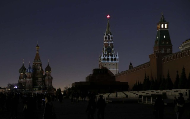 A view shows the St. Basil's Cathedral (L) and the Kremlin wall, after the lights were switched off for Earth Hour in Red Square in central Moscow, Russia, March 25, 2017. REUTERS/Maxim Shemetov