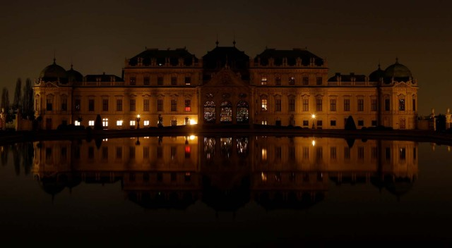 Belvedere palace and its reflection in a pond are seen after the lights were switched off for Earth Hour in Vienna, Austria, March 25, 2017. REUTERS/Heinz-Peter Bader
