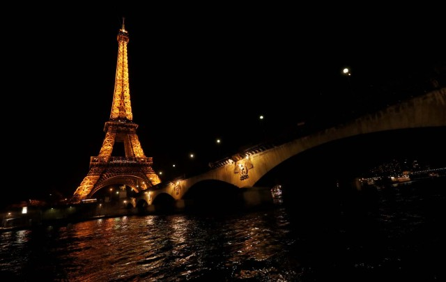 The Eiffel Tower is pictured before Earth Hour in Paris, France, March 25, 2017, at which lights are switched off around the world at 8:30 p.m. on Saturday evening to mark the 10th annual Earth Hour and to draw attention to climate change. REUTERS/Philippe Wojazer