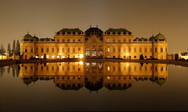 A long exposure shows Belvedere palace and its reflection in a pond after the lights were switched off for Earth Hour in Vienna, Austria, March 25, 2017. REUTERS/Heinz-Peter Bader