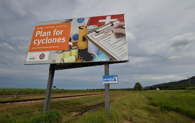 A cyclone warning sign is seen outside the city of Townsville in far north Queensland on March 27, 2017. Thousands of people including tourists were evacuated on March 27, 2017 as northeast Australia braced for a powerful cyclone packing destructive winds with warnings of major structural damage and surging tides. / AFP PHOTO / PETER PARKS