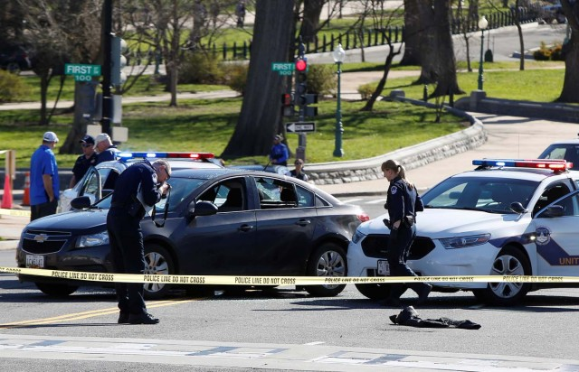 Capitol Hill police inspect a car whose driver struck a Capitol Police cruiser and then tried to run over officers, near the U.S. Capitol in Washington, U.S., March 29, 2017. REUTERS/Joshua Roberts