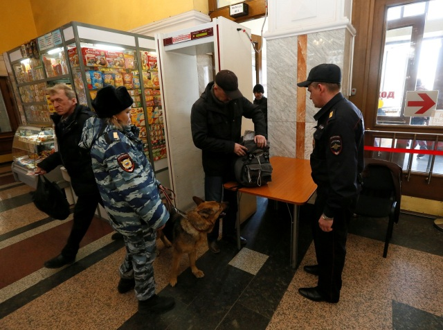 Russian police officers check a passenger at a railway station following the St. Petersburg metro blast that took place on April 3, in the Siberian city of Krasnoyarsk, Russia April 4, 2017. REUTERS/Ilya Naymushin