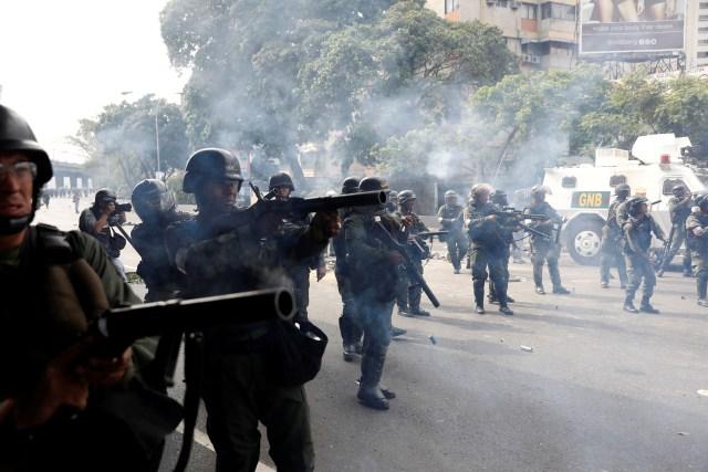 Venezuelan national guard fire tear gas towards demonstrators during an opposition rally in Caracas, Venezuela, April 6, 2017. REUTERS/Carlos Garcia Rawlins