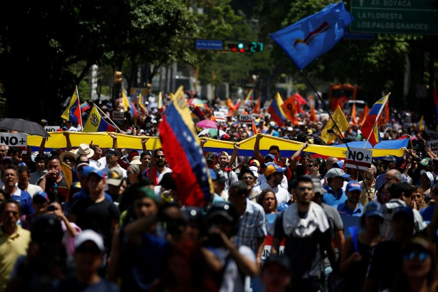 Demonstrators march during an opposition rally in Caracas, Venezuela April 6, 2017. REUTERS/Carlos Garcia Rawlins