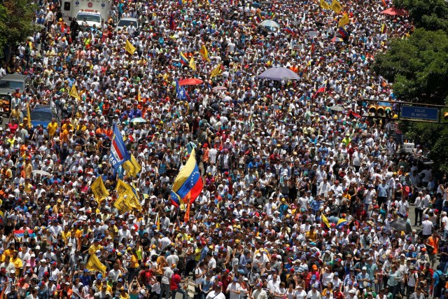People participate in an opposition rally in Caracas, Venezuela, April 8, 2017.  REUTERS/Christian Veron