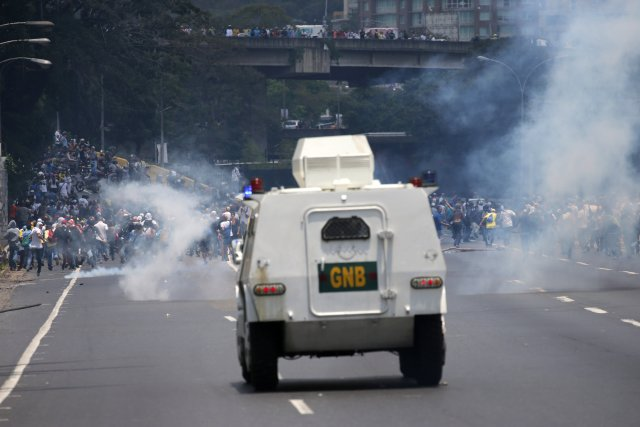 An armored car of the riot police approaches demonstrators during a rally against Venezuela's President Nicolas Maduro's government in Caracas, Venezuela April 10, 2017. REUTERS/Carlos Garcia Rawlins