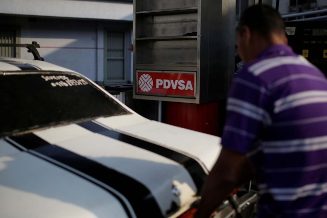 The corporate logo of the state oil company PDVSA is seen at a gas station in Caracas, Venezuela April 12, 2017. Picture taken April 12, 2017. REUTERS/Marco Bello