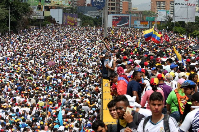 """Demonstrators march during the so-called """"mother of all marches"""" against Venezuela's President Nicolas Maduro in Caracas, Venezuela April 19, 2017. REUTERS/Carlos Garcia Rawlins"""