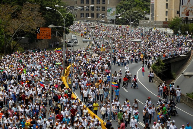 """Demonstrators rally during the so-called """"mother of all marches"""" against Venezuela's President Nicolas Maduro in Caracas, Venezuela April 19, 2017. REUTERS/Christian Veron"""