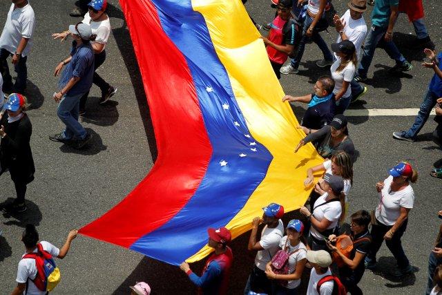 Opposition supporters rally against Venezuela's President Nicolas Maduro in Caracas, Venezuela April 20, 2017. REUTERS/Christian Veron