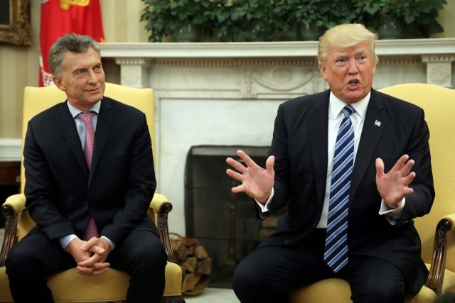 U.S. President Donald Trump talks during a meeting with Argentina's President Mauricio Macri at the Oval Office of the White House in Washington, U.S., April 27, 2017. REUTERS/Carlos Barria