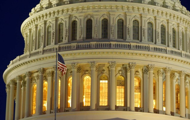 FILE PHOTO: The United States Capitol Dome is seen before dawn in Washington March 22, 2013. REUTERS/Gary Cameron/File photo