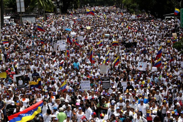 Demonstrators attend a women's march to protest against President Nicolas Maduro's government in Caracas, Venezuela, May 6, 2017. REUTERS/Marco Bello
