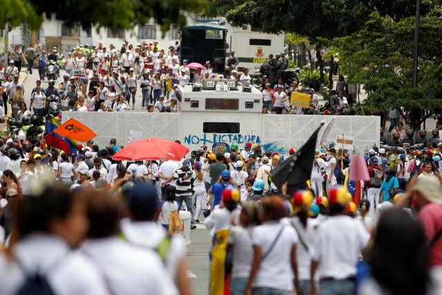 Demonstrators gather in front of the police during a women's march to protest against President Nicolas Maduro's government in Caracas, Venezuela May 6, 2017. REUTERS/Christian Veron