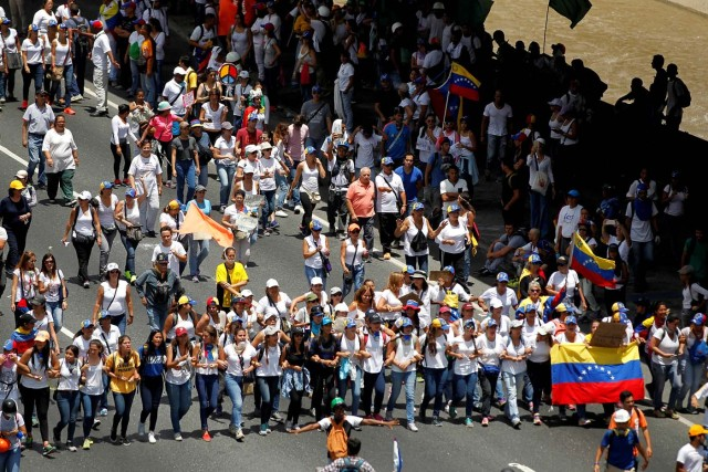 Demonstrators attend a women's march to protest against President Nicolas Maduro's government in Caracas, Venezuela May 6, 2017. REUTERS/Christian Veron