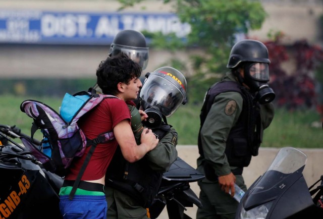 An opposition supporter is detained by riot police during a rally against Venezuelan President Nicolas Maduro in Caracas, Venezuela, May 8, 2017. REUTERS/Carlos Garcia Rawlins