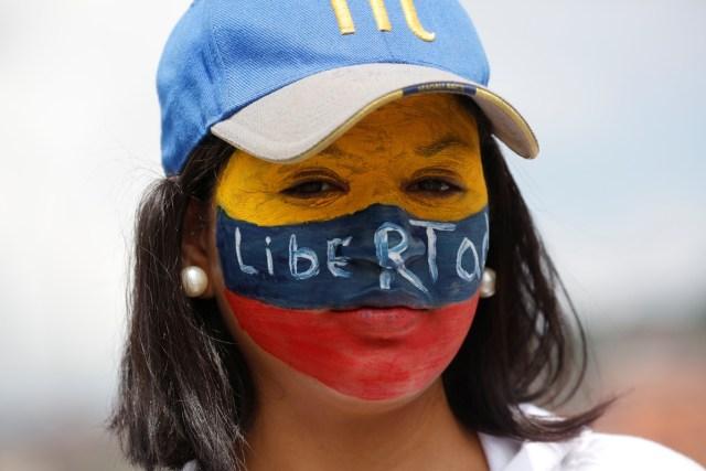 A demonstrator protests against Venezuela's President Nicolas Maduro's government in Caracas, Venezuela, May 13, 2017. REUTERS/Carlos Garcia Rawlins