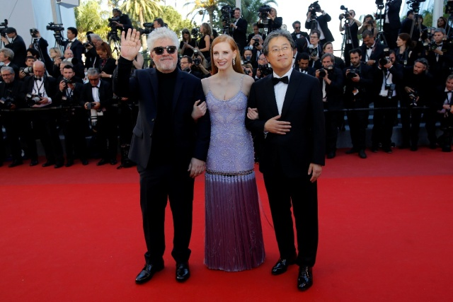 "70th Cannes Film Festival - Screening of the film ""Okja"" in competition - Red Carpet Arrivals- Cannes, France. 19/05/2017. Director Pedro Almodovar, Jury President of the 70th Cannes Film Festival, and Jury members Jessica Chastain and Park Chan-wook pose. REUTERS/Stephane Mahe"