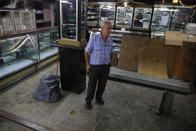 Manuel Fernandes, a local businessman, stands inside of his bread and cake shop after looters broke in, following days of protest against Venezuelan President Nicolas Maduro in the city of Los Teques, near Caracas, Venezuela, May 19, 2017. REUTERS/Carlos Barria