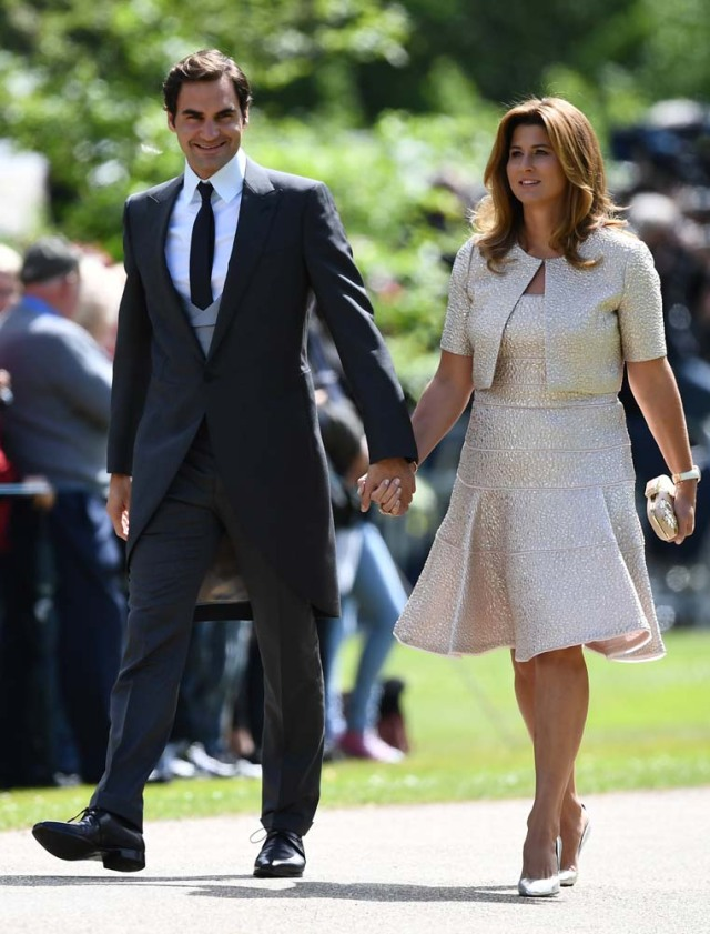 Swiss tennis player Roger Federer and his wife Mirka attend the wedding of Pippa Middleton, the sister of Britain's Catherine, Duchess of Cambridge, and James Matthews at St Mark's Church in Englefield, west of London, on May 20, 2017. REUTERS/Justin Tallis/Pool