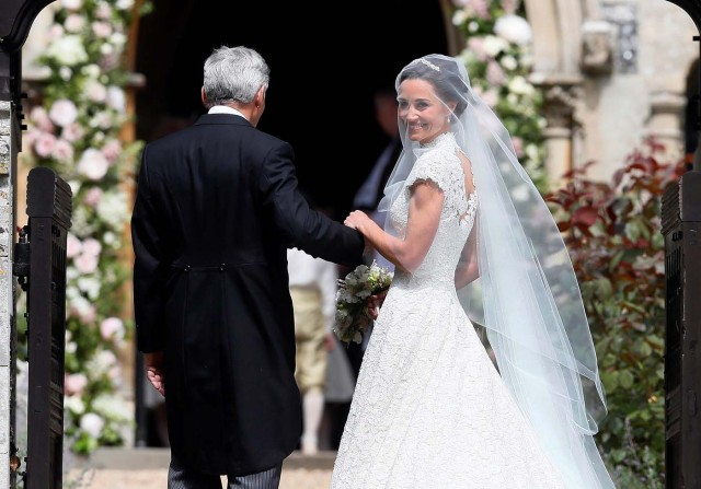 Pippa Middleton, the sister of Britain's Catherine, Duchess of Cambridge, arrives with her father Michael Middleton for her wedding to James Matthews at St Mark's Church in Englefield, west of London, on May 20, 2017. REUTERS/Kirsty Wigglesworth/Pool
