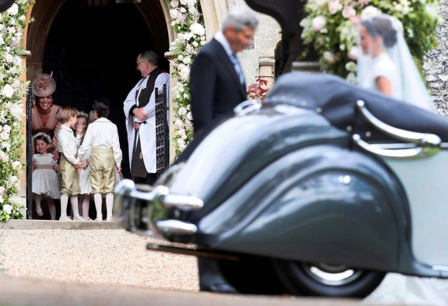Britain's Catherine, Duchess of Cambridge (L) stands with her daughter Princess Charlotte, (BOTTOM L) as they arrive for the wedding of Pippa Middleton (R) and James Matthews at St Mark's Church in Englefield, west of London, on May 20, 2017. REUTERS/Kirsty Wrigglesworth/Pool