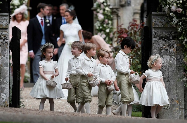 Britain's Prince George stands with other flower boys and girls after the wedding of Pippa Middleton and James Matthews at St Mark's Church in Englefield, Britain May 20, 2017. Pippa Middleton is the sister of Catherine, Duchess of Cambridge.  REUTERS/Kirsty Wigglesworth/Pool