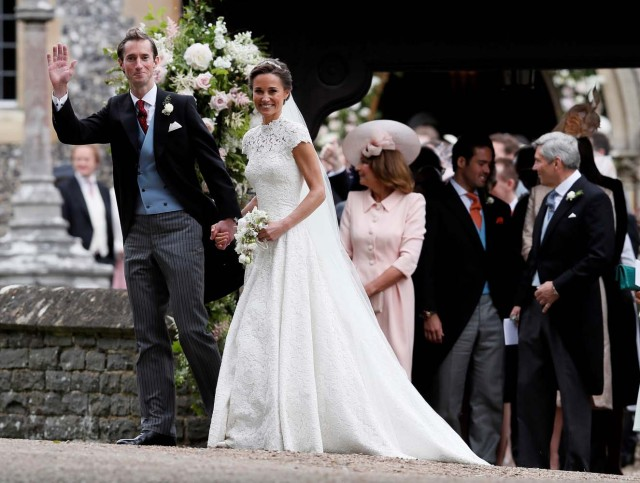 Pippa Middleton and James Matthews smile after their wedding at St Mark's Church in Englefield, Britain May 20, 2017. Pippa Middleton is the sister of Catherine, Duchess of Cambridge.  REUTERS/Kirsty Wigglesworth/Pool