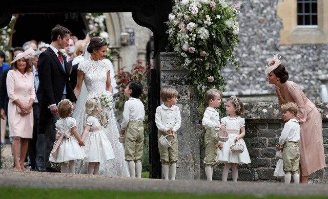 Britain's Catherine, Duchess of Cambridge stands with her son Prince George as she looks across at Pippa Middleton and James Matthews after their wedding at St Mark's Church in Englefield, Britain May 20, 2017. Pippa Middleton is the sister of Catherine, Duchess of Cambridge.  REUTERS/Kirsty Wigglesworth/Pool