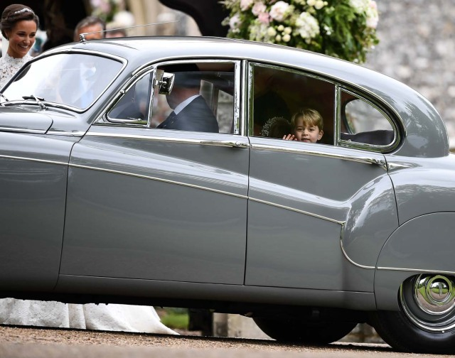 Britain's Prince George waves as he leaves in a car after attending the wedding of his aunt, Pippa Middleton, to James Matthews at St Mark's Church in Englefield, Britain May 20, 2017. Pippa Middleton is the sister of Catherine, Duchess of Cambridge.  REUTERS/Justin Tallis/Pool