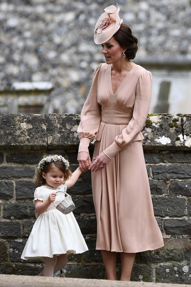 Britain's Catherine, Duchess of Cambridge stands with her daughter Princess Charlotte, a bridesmaid, following the wedding of her sister Pippa Middleton to James Matthews at St Mark's Church in Englefield, west of London, on May 20, 2017.    REUTERS/Justin Tallis/Pool