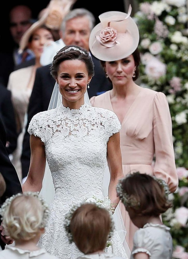 Britain's Catherine, Duchess of Cambridge follows the bride, her sister Pippa Middleton, after her wedding to James Matthews at St Mark's Church in Englefield, west of London, on May 20, 2017.    REUTERS/Kirsty Wigglesworth/Pool
