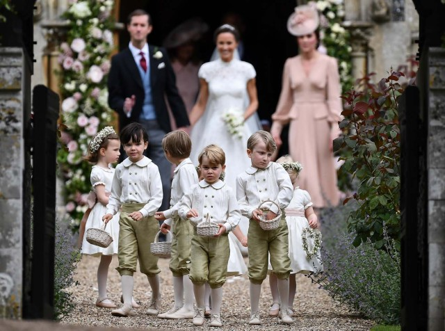 Britain's prince George, a pageboy, reacts following the wedding of his aunt Pippa Middleton to her new husband James Matthews, at St Mark's Church in Englefield, Britain on May 20, 2017.    REUTERS/Justin Tallis/Pool