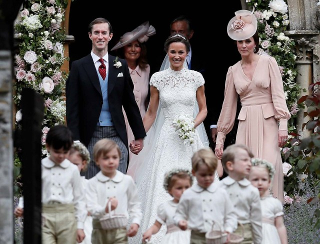 Pippa Middleton and James Matthews smile as they are joined by Britain's Catherine, Duchess of Cambridge after their wedding at St Mark's Church in Englefield, Britain on May 20, 2017.    REUTERS/Kirsty Wigglesworth/Pool