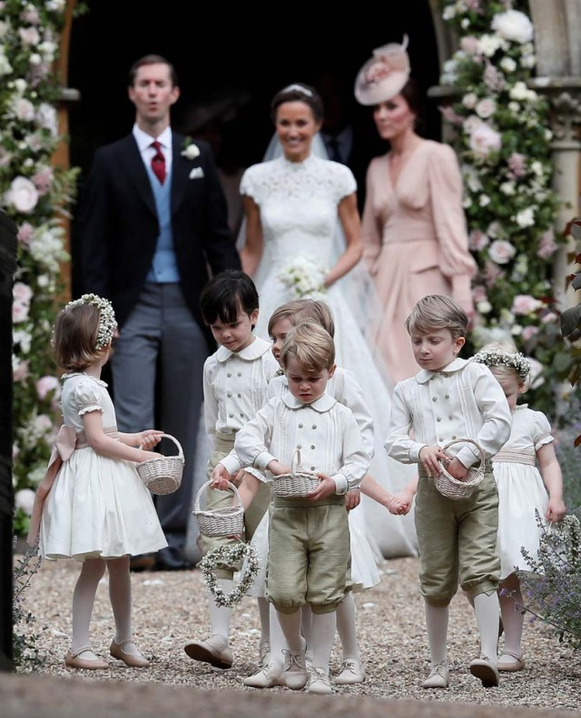 Britain's Prince George stands with other flower boys and girls, and his mother Catherine, Duchess of Cambridge after the wedding of Pippa Middleton and James Matthews at St Mark's Church in Englefield, Britain on May 20, 2017.    REUTERS/Kirsty Wigglesworth/Pool
