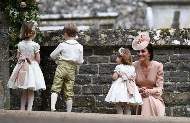Britain's Catherine, Duchess of Cambridge stands with her daughter Princess Charlotte, a bridesmaid, following the wedding of her sister Pippa Middleton to James Matthews at St Mark's Church in Englefield, Britain on May 20, 2017.    REUTERS/Justin Tallis/Pool