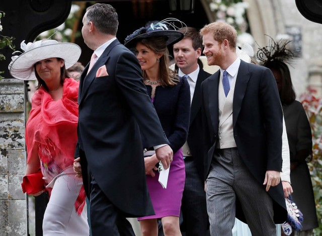 Britain's Prince Harry leaves after the wedding of Pippa Middleton and James Matthews at St Mark's Church in Englefield, Britain May 20, 2017. REUTERS/Kirsty Wigglesworth/Pool