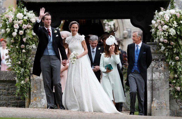 Pippa Middleton and James Matthews smile after their wedding at St Mark's Church in Englefield, Britain May 20, 2017. REUTERS/Kirsty Wigglesworth/PoolPhoto/Kirsty Wigglesworth, Pool)