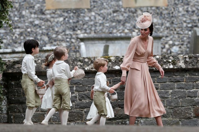 Britain's Catherine, Duchess of Cambridge walks with the flower boys and girls after the wedding of Pippa Middleton and James Matthews at St Mark's Church in Englefield, west of London, on May 20, 2017. REUTERS/Kirsty Wigglesworth/Pool